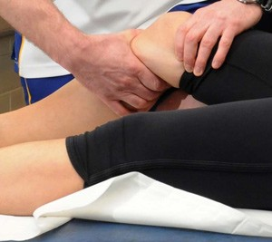 Patient receiving sports therapy treatment
